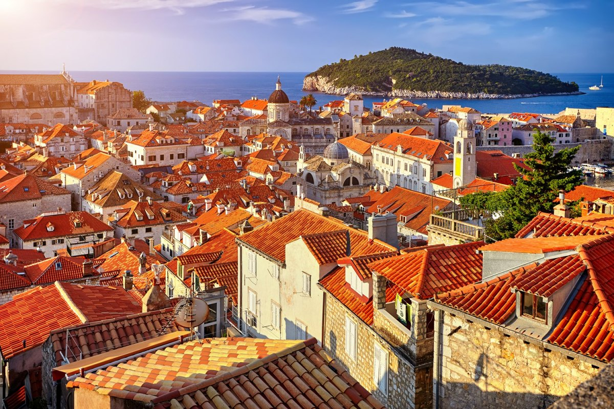 Croatia Panorama Dubrovnik Old Town roofs at sunset. Europe